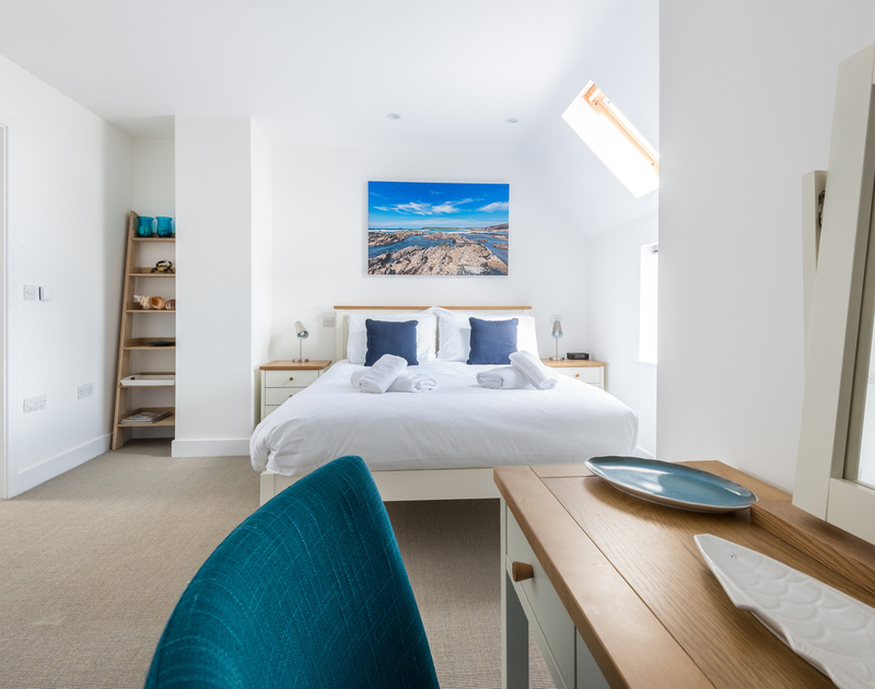 The beautifully decorated and furnished master king size bedroom on the first floor bedroom at Rainer Rocks, a luxury holiday retreat in Polzeath.