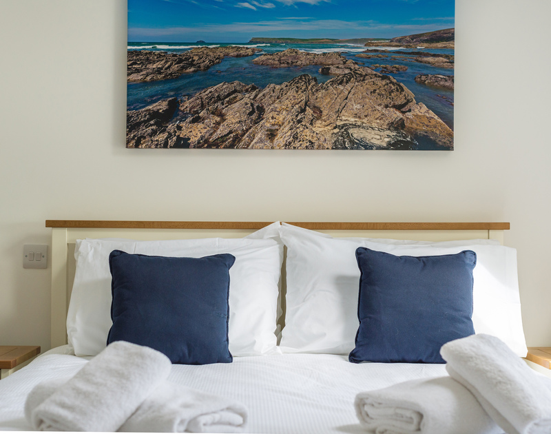 Go to sleep to the sound of the waves in the airy master bedroom at Rainer Rocks in Polzeath, Cornwall