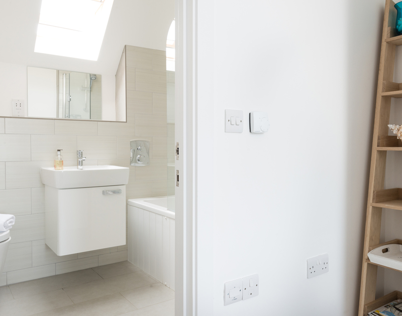 The bright, stylish master bedroom ensuite on the second floor at Rainer Rocks, Polzeath.