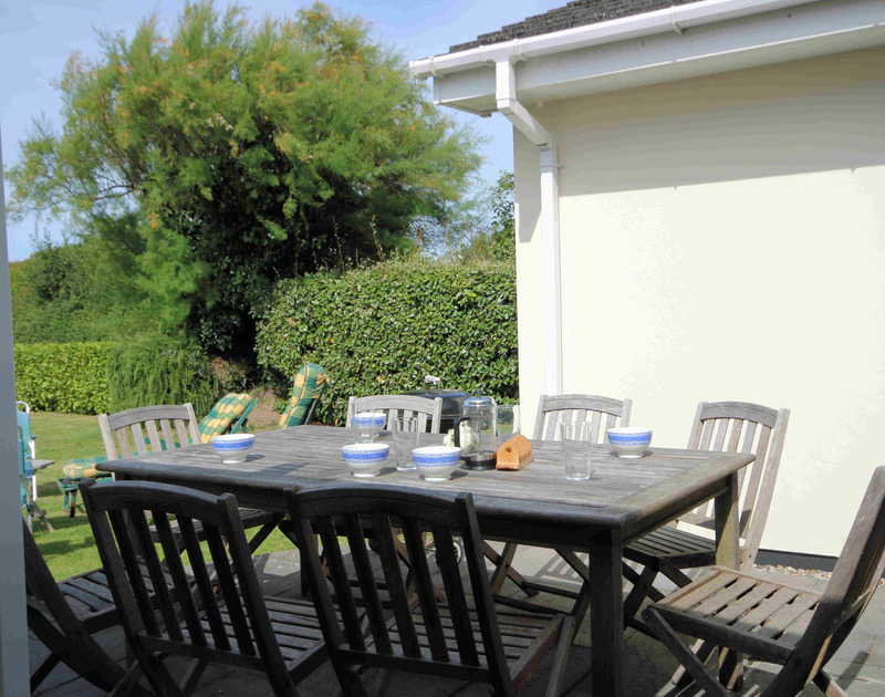 The sunny patio table and chairs at Trewin, a self catering holiday property to rent in Rock, Cornwall.