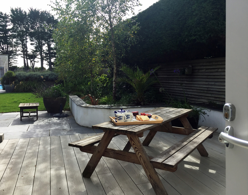 From the ground floor twin bedroom at Trerokken you can take your breakfast outside on sunny mornings to enjoy the garden.