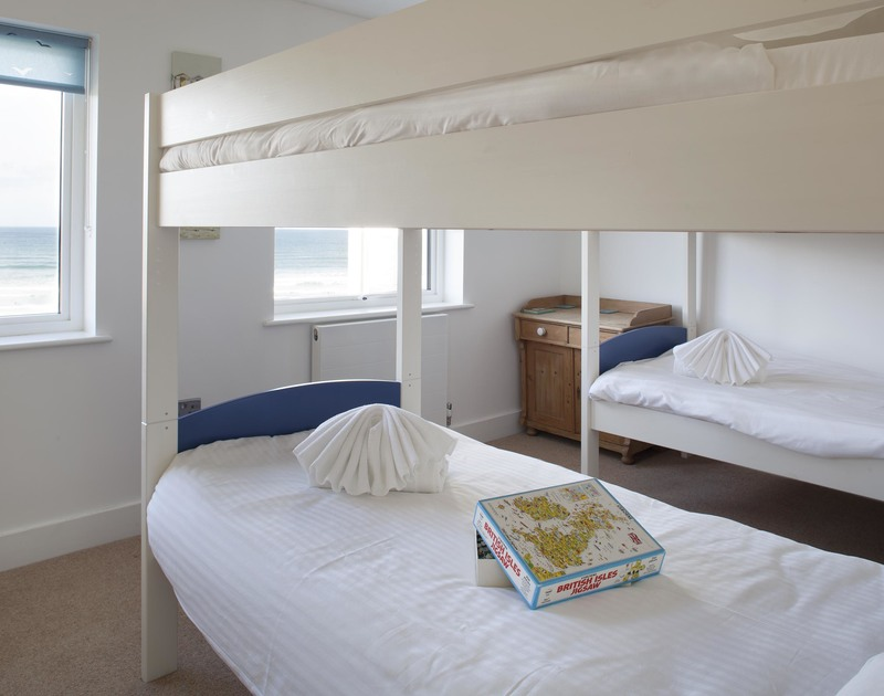 Children will love sleeping in together in the double bunk beds in bedroom three at The Whitehouse in Polzeath, Cornwall.