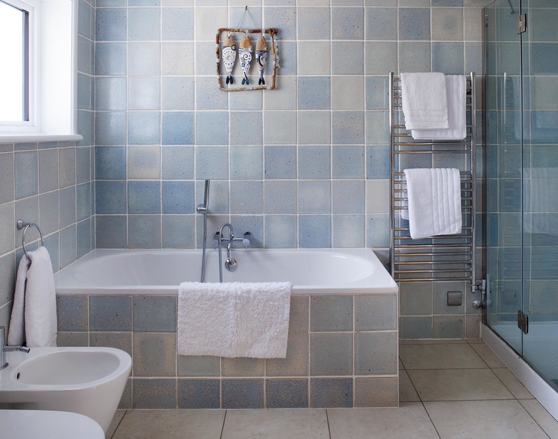 Luxuriate in the master ensuite bathroom at The Whitehouse in Polzeath, which offers a walk in shower and bath.