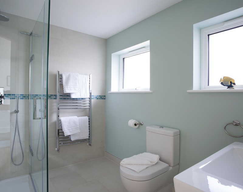 The family shower room off the entrance hall at The Whitehouse in Polzeath offers a large walk-in shower
