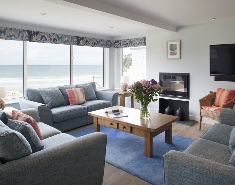 From its elevated position, the large open plan living room at The Whitehouse in Polzeath, North Cornwall, affords incredible panoramic sea views.
