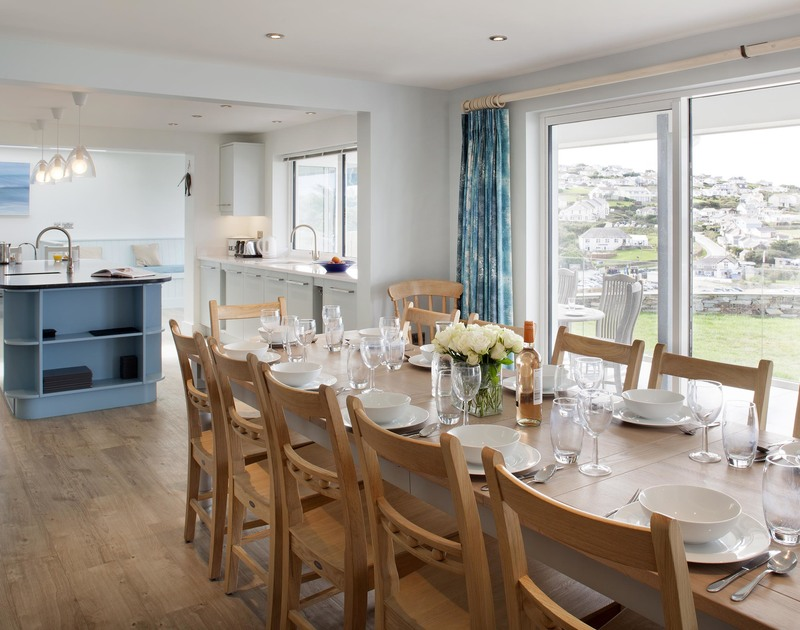 The ground floor at The Whitehouse in Polzeath is one large open plan living space including the living room, dining room, kitchen and breakfast seating.