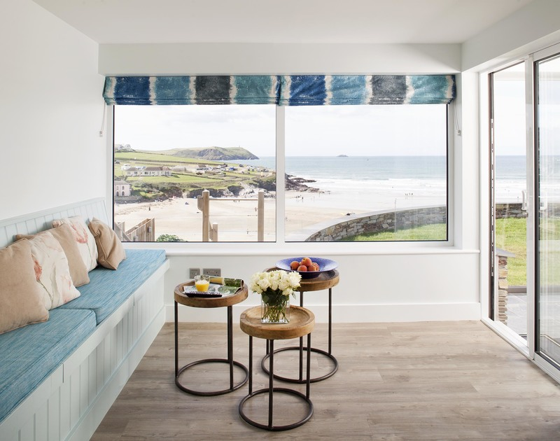 Be the first to hit the surf with the panoarmic sea views from the snug at The Whitehouse, a holiday house to rent in Polzeath,Cornwall.
