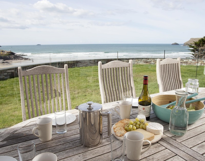 Invite friends and family over to The Whitehouse to enjoy alfresco dining on the veranda overlooking the beach at Polzeath, Cornwall.