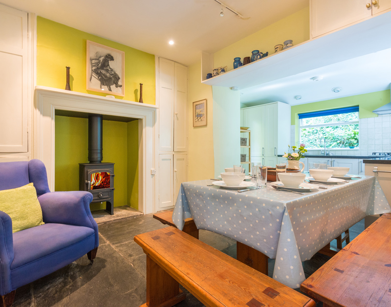 Light the fire on cool evenings and enjoy home cooked meals at St Enodoc Cottage, a holiday home in Daymer Bay, Cornwall