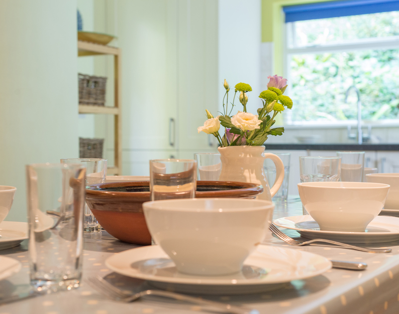 Enjoy long relaxing family meals in the cosy kitchen dining room at St Enodoc Cottage in North Cornwall.