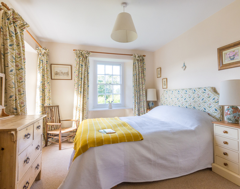 The master bedroom with en-suite in St Enodoc Cottage, a self catering seaside holiday house to rent in Daymer Bay, North Cornwall.
