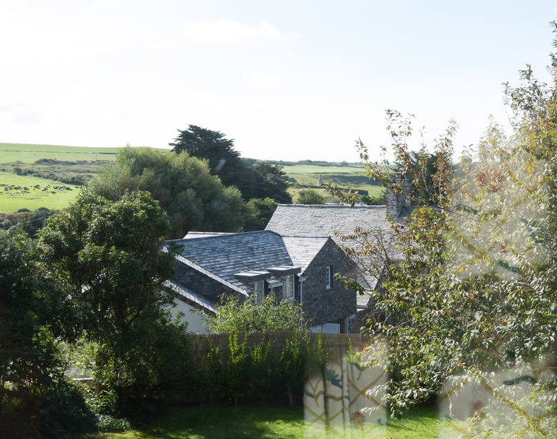 The master bedroom at St Enodoc Cottage in Daymer Bay, offers pretty countryside views towards St Enodoc Church and the golf course.