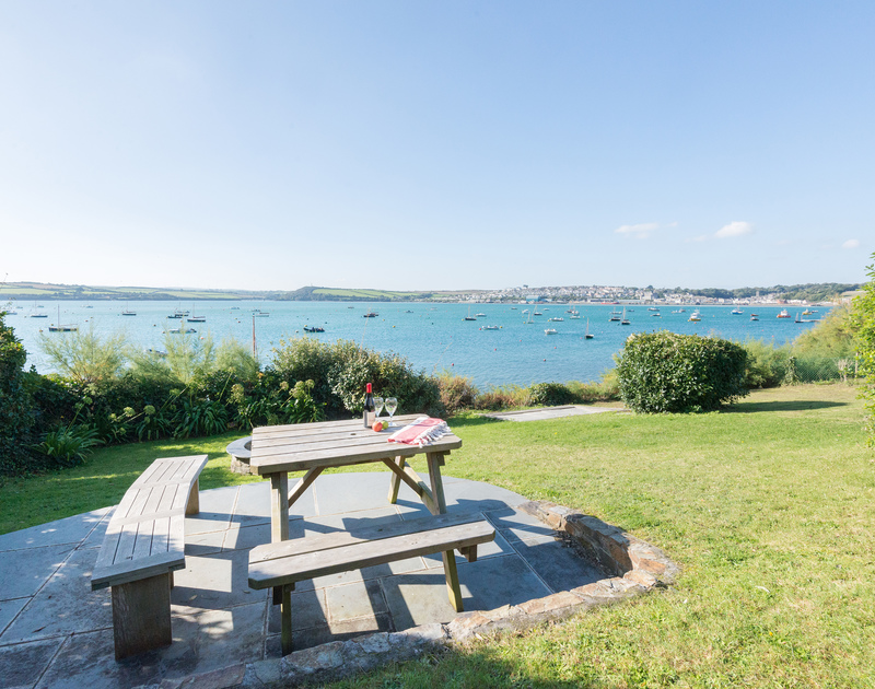 Make time to enjoy a drink or meal at the table in the waterfront gardens at self catering, holiday house 2, The Terrace in Rock on the North Cornwall coast.