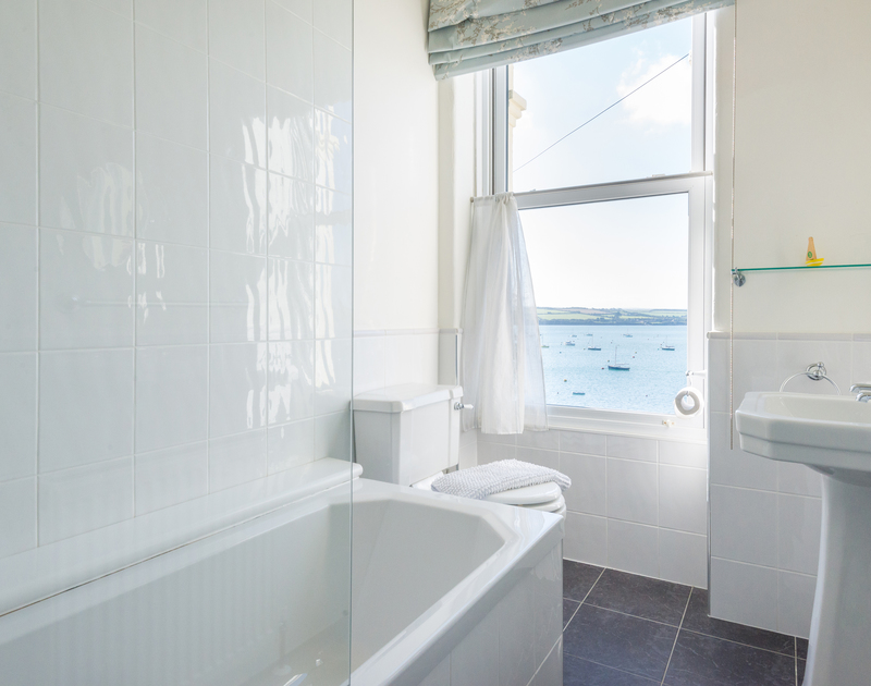 Even the family bathroom at 2, The Terrace has wonderful sea views over the Camel Estuary in Rock.