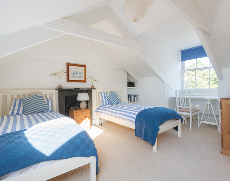Gorgeous original features in the bright twin bedroom in the eaves at 2, The Terrace, a waterside holiday property in Rock, North Cornwall.