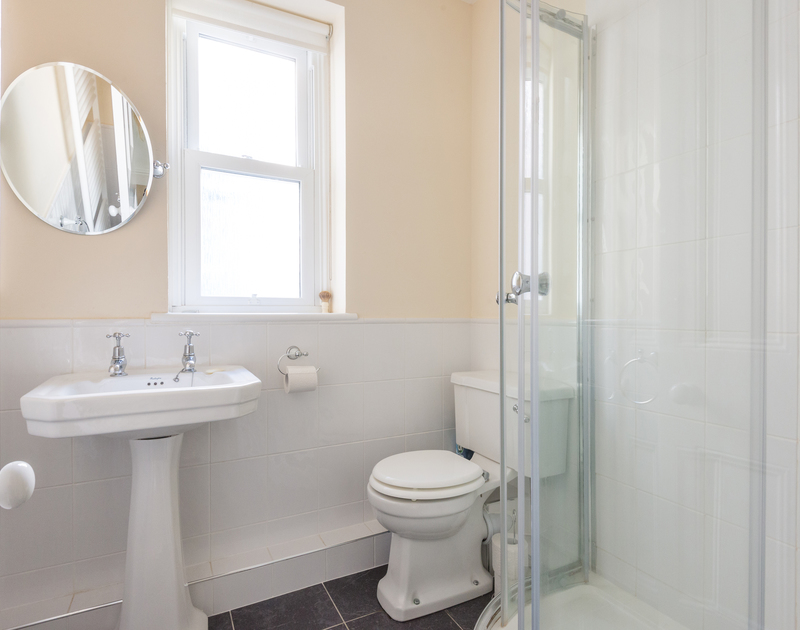 Cool, white shower room at 2, The Terrace, a self catering holiday house in Rock, Cornwall.