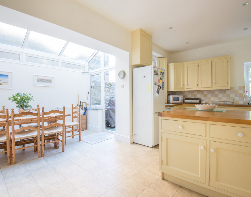 Light, sociable open plan kitchen and dining room at 2, The Terrace, a self catering holiday property to rent in Rock, Cornwall.