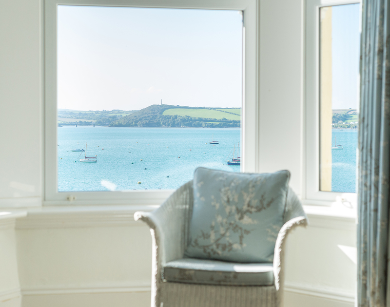 The sea views towards Padstow over the bobbing boats on their moorings from the elevated setting of the bay window in the master bedroom at 2, The Terrace in Rock.