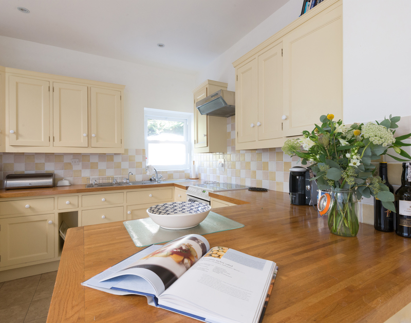 The shaker style kitchen at 2, The Terrace, a family holiday house on the Camel Estuary in Rock, North Cornwall.