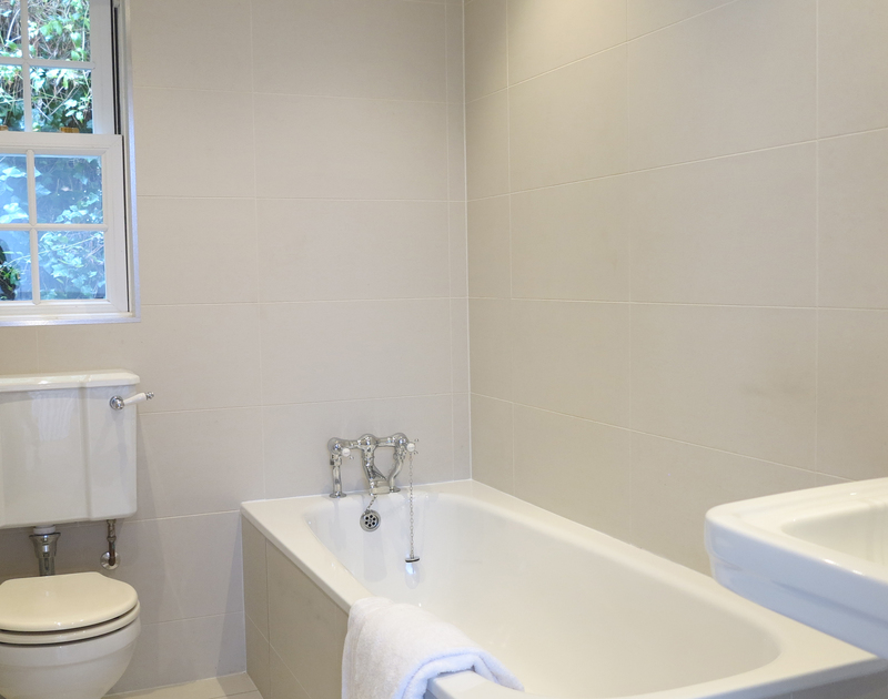 The first floor family bathroom at Old Brea Coach House a self catering holiday home in Daymer Bay, North Cornwall.