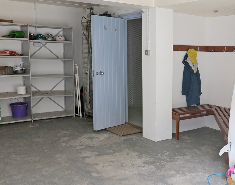 The large garage at Old Brea Coach House offers plenty of storage and a wet room to shower off the sand after busy days on nearby Daymer Bay beach.