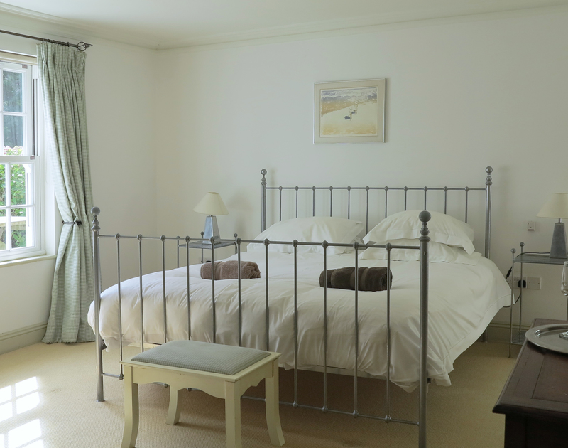 The serene, light and spacious master bedroom suite at Old Coach House in Daymer Bay, North Cornwall.