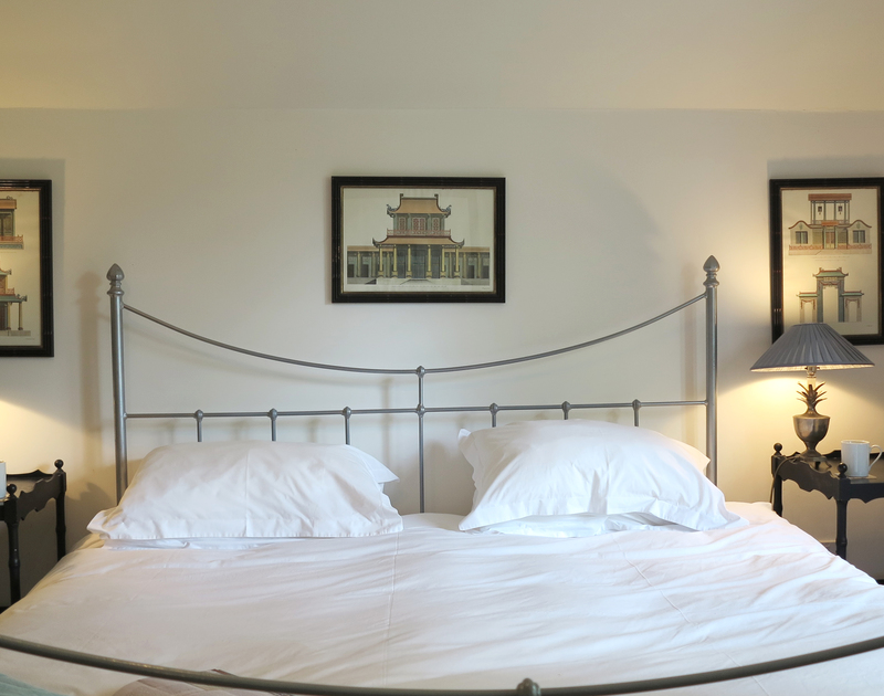 The elegant superking size bedroom at Old Brea Coach House, a self catering holiday home near Daymer Bay.