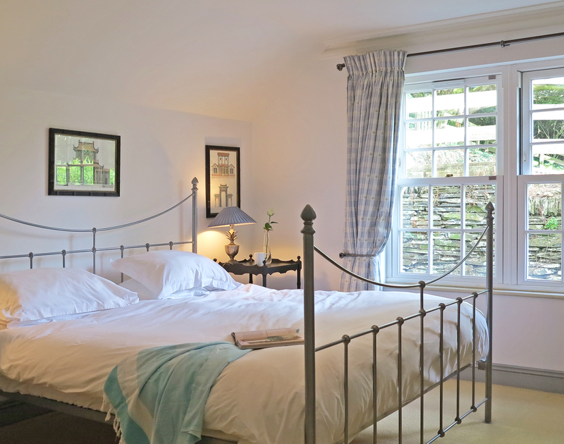 The elegant double bedroom of Old Brea Coach House, a holiday house on the North coast of Cornwall