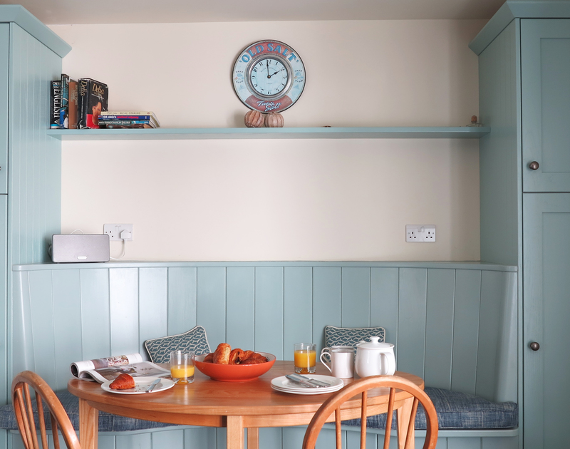 Plan your day's activities while you breakfast in the kitchen nook at Harbour Lights, Rock on the north Cornwall coast.