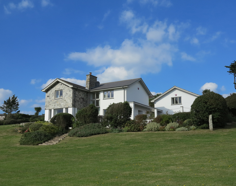 The side exterior  of Harbour Lights, self-catering holiday house in Rock, Cornwall showing the mature sloping gardens