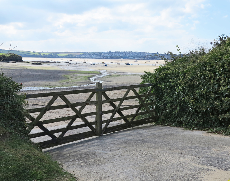 The gate at the bottom of the garden at Harbour Lights in Rock, leads right onto Porthilly cove on Rock beach.