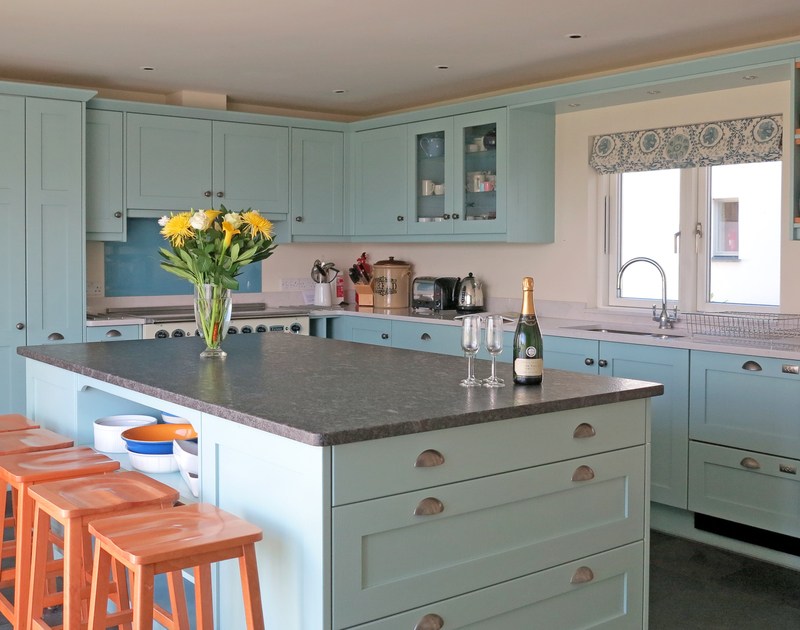 The large central island and bespoke kitchen cupboards at Harbour Lights, holiday house in Rock, Cornwall
