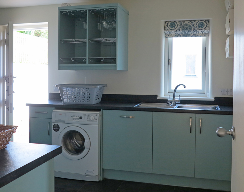 The practical and spacious utility room at Harbour lights in North Cornwall