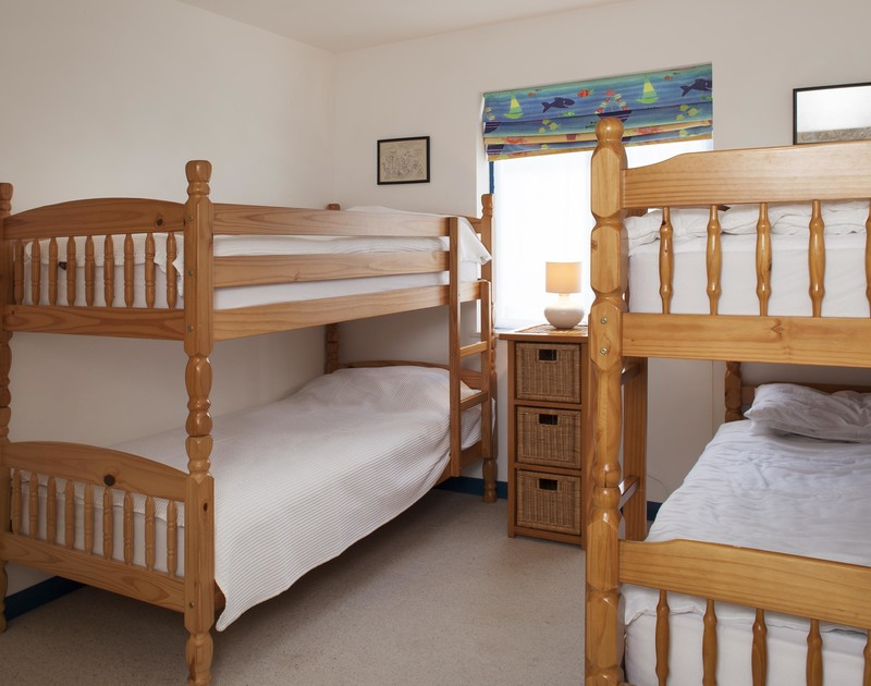 Children will enjoy bunking in together in the bunk bedroom at Belmont in Rock on the North Cornwall coast