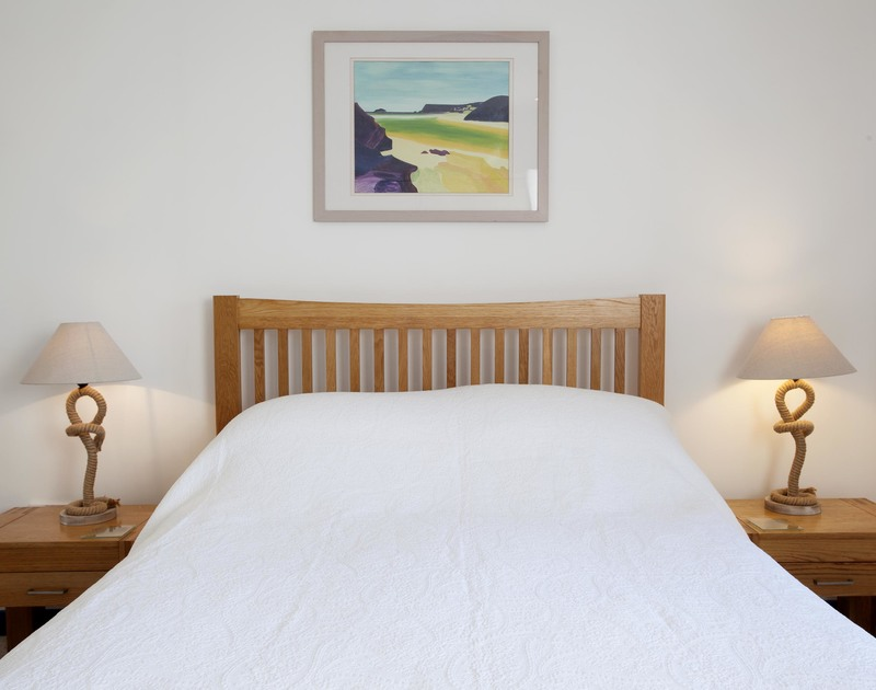 The light and comfortable master bedroom at Belmont in Rock, is located by the Camel Estuary and has nautical touches throughout.
