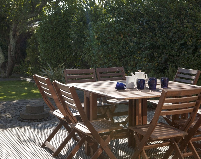 Stop for a morning coffee or afternoon tea on the patio furniture in the sunny garden at Belmont in Rock, North Cornwall