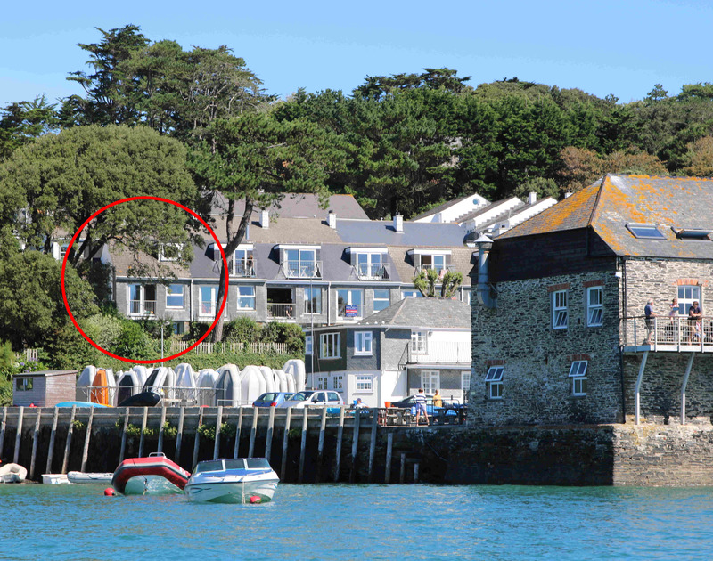 Gorgeous One Slipway Cottage as seen from the water, a South facing holiday rental in Rock with garden and lovey views, Cornwall, with bench and table.