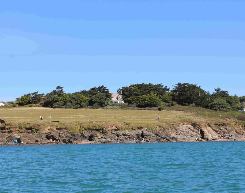 The view of the amazing Doom Bar House from a boat on the estuary at Daymer. The large house has sheltered lawns and is perfect any beach holiday.