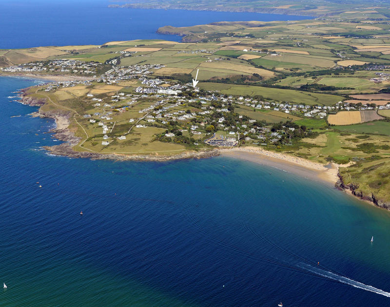 A high level aerial photo of Daymer Bay in Cornwall showing an arrow to the location of Appleby a self catering holiday home inbetween Daymer Bay and Polzeath, Cornwall
