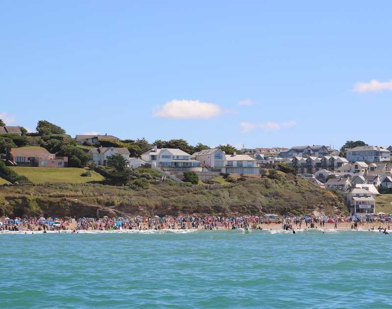 A photo of The White House taken from the sea on a summers day, this fantastic cliff top location could possibly be the perfect holiday house in New Polzeath, Cornwall.