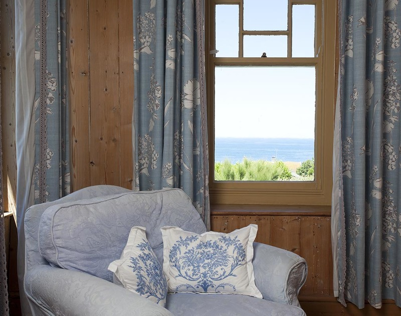 Curl up with a book or simply enjoy the sky and sea views from a cosy armchair in Fronthill House, a self catering holiday house in the picturesque setting of Port Isaac.