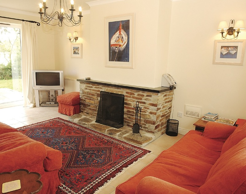 The comfortable living room in Tresow,  a self catering holiday house to rent in Tredrizzick near Rock in North Cornwall.