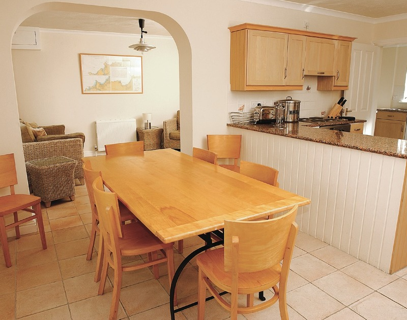 The bright open plan kitchen and dining room in Tresow, a self catering holiday rental in Tredrizzick near Rock in North COrnwall.