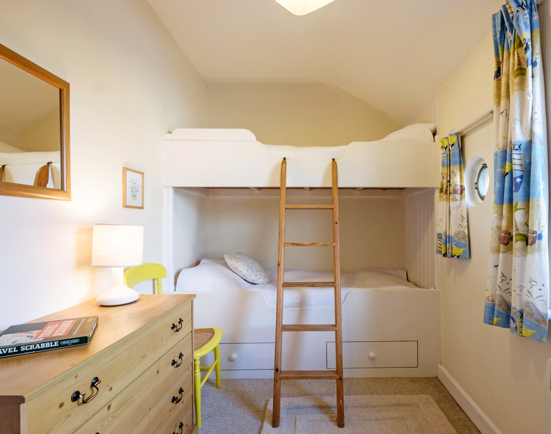 The cabin inspired bunk bedroom at the back of Coppingers Cottage in Polzeath, North Cornwall