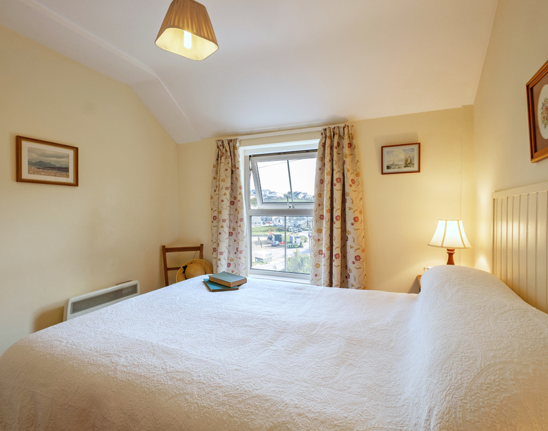 Enjoy views of Polzeath beach from the double bedroom at Coppingers Cottage, on the North Cornwall coast