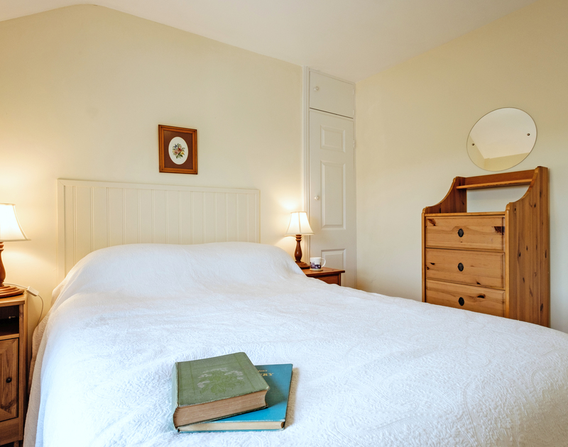 Enjoy a restful night listening to the sounds of the sea at Coppingers Cottage, a holiday house in Polzeath, Cornwall
