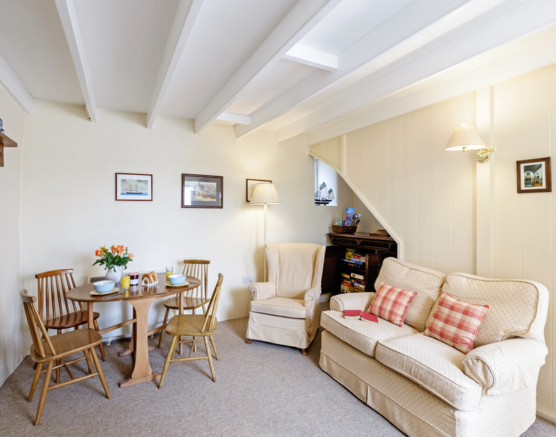 Cosy up with a book, play a board game or watch a family movie in the living room at Coppingers Cottage in Polzeath
