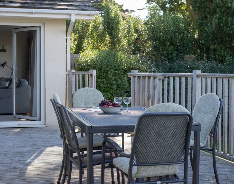 The sheltered decking at The Glowdgie, a traditional self catering holiday home in New Polzeath, near Polzeath Cornwall.