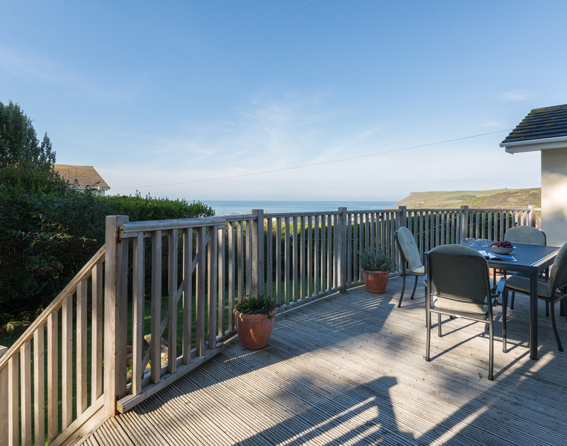 The view over to Pentire Point from the decking at The Glowdgie, a traditional self catering holiday home in New Polzeath near Polzeath Cornwall.