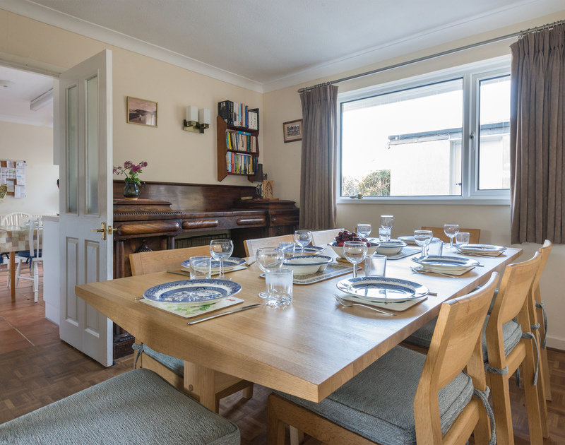 The traditional styled dining room at The Glowdgie, a self catering holiday home in New Polzeath, near Polzeath Cornwall.